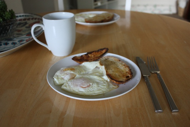 eggs and toast for breakfast with a side of coffee