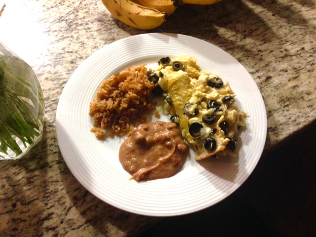 homemade dinner at a friends house enchiladas, rice, and beans