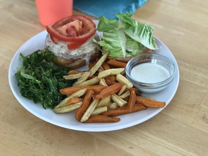 Turkey burger, fries, and seaweed salad